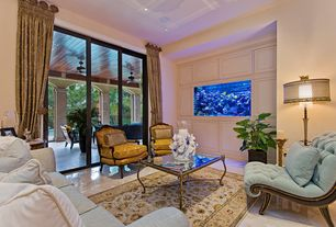 Traditional Living Room with Concrete floors, French doors, Built-in fish tank, can lights, Transom window, High ceiling