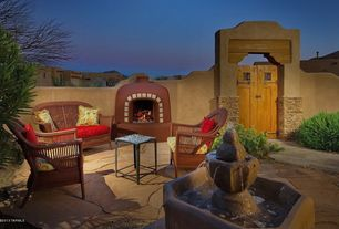 Eclectic Patio with exterior stone floors, Fountain, Gate, Fence, W Unlimited Brown Wicker 4-piece Outdoor Furniture Set