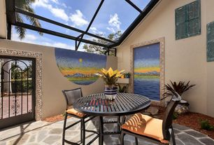 Mediterranean Patio with Gate, exterior stone floors, Fence
