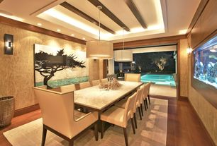 Contemporary Dining Room with Sliding glass walls, Tray ceiling with accent lighting, Crown molding, Built-in fish tank