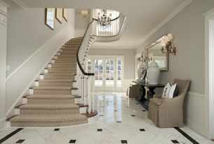 Traditional Staircase with Laminate floors, High ceiling, Wainscotting, Wall sconce, Crown molding