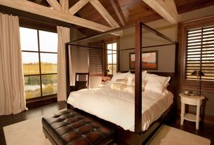 Cottage Master Bedroom with Hardwood floors, picture window, Exposed beam, Casement, Standard height