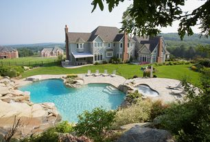 Traditional Swimming Pool with exterior awning, Rock landscaping, Pathway, French doors, Outdoor seating, Pool with hot tub