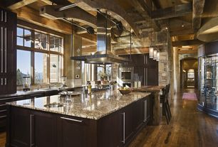 Rustic Kitchen with double wall oven, Island Hood, Limestone Tile, Kitchen island, electric cooktop, Casement, Stone Tile