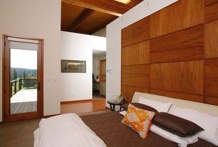 Contemporary Master Bedroom with Laminate floors, Glass panel door, High ceiling, Exposed beam