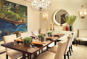 Contemporary Dining Room with Paint, Chandelier, Amber glass candle sticks, Orange cloth napkins, Built-in bookshelf, Carpet