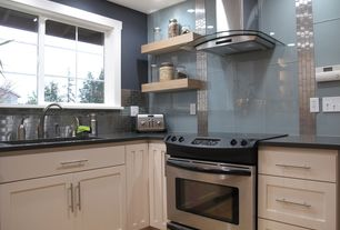 Modern Kitchen with Paint, Undermount sink, Arietta dekor stainless and glass wall hood, Electric slide in range