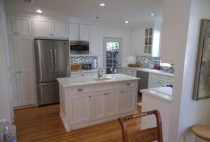 Cottage Kitchen with Framed Partial Panel, Undermount sink, gas range, Simple marble counters, Ceramic Tile, French doors