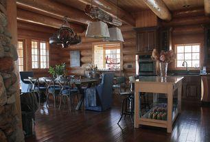 Rustic Dining Room with Chandelier, High ceiling, Casement, Restoration hardware vintage toledo bar chair, Hardwood floors