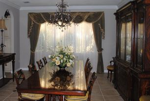 Traditional Dining Room with Standard height, sandstone tile floors, Crown molding, stone tile floors, picture window