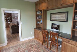 Traditional Home Office with Laminate floors, Built-in bookshelf, Standard height