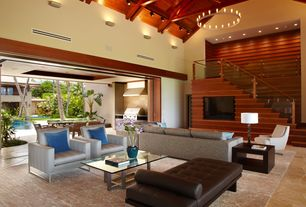 Tropical Living Room with Cathedral ceiling, Chandelier, Wall sconce, Exposed beam, slate floors, flush light