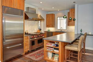 Contemporary Kitchen with dishwasher, can lights, Wall Hood, Built In Refrigerator, Concrete counters, Glass Tile, U-shaped