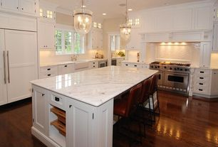 Traditional Kitchen with Arizona tiles islandia series, Custom hood, Complex marble counters, Glass panel, Pendant light