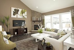 Contemporary Living Room with Fireplace, High ceiling, can lights, Hardwood floors, double-hung window, stone fireplace