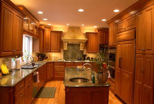 Traditional Kitchen with Simple granite counters, Framed Partial Panel, Built In Panel Ready Refrigerator, electric cooktop