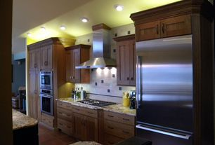 Contemporary Kitchen with Simple granite counters, One-wall, Large Ceramic Tile, Framed Partial Panel, Kitchen island
