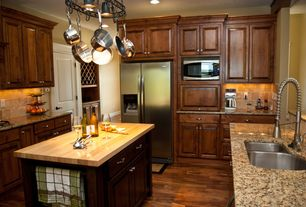 Traditional Kitchen with Jeffrey alexander hard maple butcher block top, Wood counters, U-shaped, Stone Tile, Pendant light