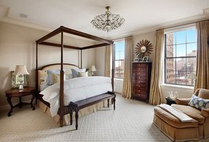 Traditional Master Bedroom with Mahogany side table with cabriole legs, Carpet, Crown molding, Chandelier, Walnut canopy bed