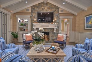 Traditional Great Room with Laminate floors, High ceiling, Built-in bookshelf, can lights, Fireplace, stone fireplace