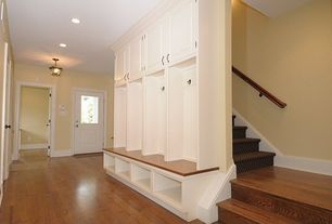 Traditional Entryway with can lights, Custom built entry storage bench, Paint 1, Oak hardwood flooring, Lantern pendant