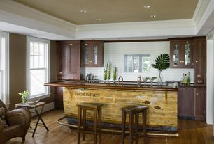 Cottage Bar with Crown molding, Hardwood floors, Built-in bookshelf