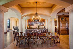 Mediterranean Dining Room with travertine floors, Chandelier, Crown molding, High ceiling, Columns