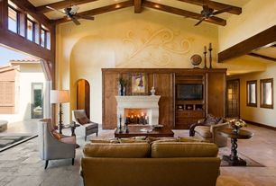 Mediterranean Living Room with Exposed beam, Concrete tile , picture window, Built-in bookshelf, can lights, High ceiling