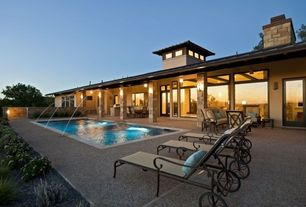 Modern Swimming Pool with Lap pool, Transom window, Pathway, French doors, Outdoor kitchen, exterior tile floors