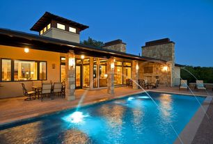 Modern Swimming Pool with exterior concrete tile floors, Lap pool, picture window, exterior tile floors, Deck Railing