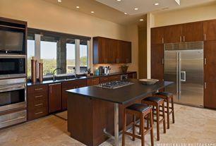 Modern Kitchen with Limestone Tile, Wine refrigerator, Wusthof Gourmet 12 Piece Block Set, Flush, Stone Tile, Undermount sink