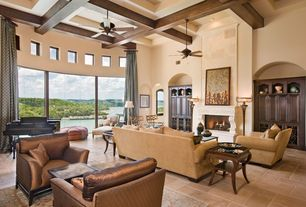 Traditional Living Room with Ceiling fan, High ceiling, Fireplace, Exposed beam, Box ceiling, can lights, picture window