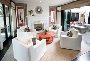 Contemporary Living Room with Crate and Barrel Sisal Linen Rug, Laminate floors, Crown molding, French doors