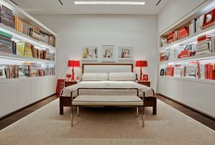 Contemporary Master Bedroom with Built-in bookshelf, Hardwood floors