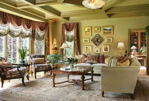 Traditional Living Room with Wilshire spooled leg exposed wood arm chair, Box ceiling, flush light, Built-in bookshelf
