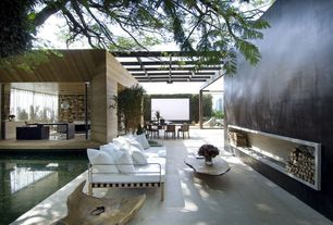 Contemporary Patio with Trellis, Fence, Large wood framed outdoor sofa