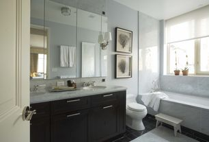 Contemporary Master Bathroom with Casement, flush light, Concrete tile , Wall sconce, can lights, Double sink, drop-in sink