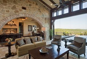 Mediterranean Living Room with High ceiling, picture window, Ceiling fan, can lights, Exposed beam, Hardwood floors