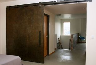 Contemporary Guest Bedroom with Home & More Natural Beige Area Rug, Barn door