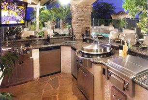 Tropical Patio with Fence, 52-inch tortuga bowl light bronze ceiling fan, Sunstone Grills Slide-In Double Side Burner