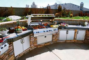 Rustic Patio with Outdoor kitchen, Sunstone grills flush double access doors, Sunstone Grills Slide-In Double Side Burner