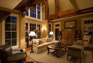 Craftsman Living Room with Exposed beam, Upholstered settee, Large seagrass area rug, Cathedral ceiling, Wall sconce, Sofa