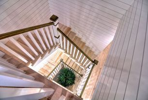 Traditional Staircase with High ceiling, Spiral staircase, Hardwood floors