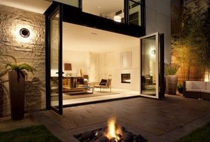 Contemporary Patio with Nana folding glass wall, Fire pit, picture window, exterior concrete tile floors, Fence, French doors