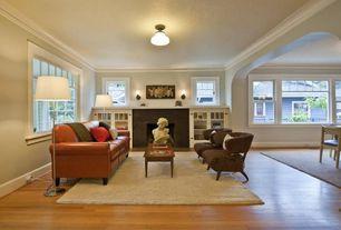 Modern Living Room with Hardwood floors, Area rug, Built-in bookshelf, Fireplace, double-hung window, Paint