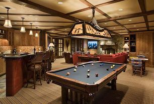 Country Game Room with Billiard light, Undercabinet lighting, Built in bar, Standard height, Exposed beam, stone fireplace