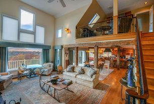 "Country Great Room with Wood columns, Paint, Loft, Open concept, Coffee table - hook up ""reindeer"" coffee table - mlct565"