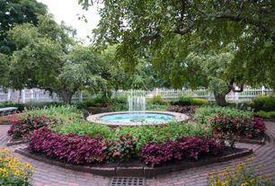 Traditional Landscape/Yard with Fountain, exterior brick floors, Pathway, Fence, Raised beds