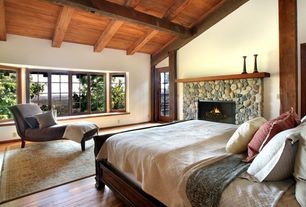 Traditional Master Bedroom with High ceiling, Hardwood floors, Glass panel door, Window seat, Bay window, Fireplace