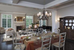 Traditional Great Room with Crown molding, Wall sconce, French doors, Chandelier, stone fireplace, Exposed beam